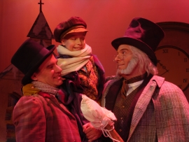 Brad Hauskins, Jordan Schmidt, and Adam Michael Lewis in A Christmas Carol
