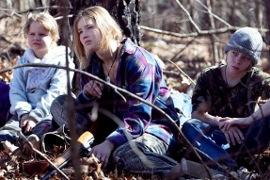 Ashlee Thompson, Jennifer Lawrence, and Isaiah Stone in Winter's Bone