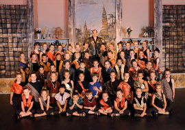 Jonathan Schrader (top) and the king's children in The King & I