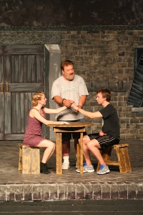 Sydney Crumbleholme, Dave Arnold, and Kyle DeFauw rehearse Les Miserables