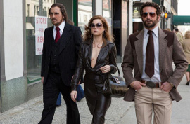 Christian Bale, Amy Adams, and Bradley Cooper in American Hustle