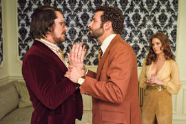 Christian Bale, Bradley Cooper, and Amy Adams in American Hustle