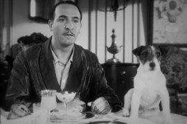 Jean Dujardin and Uggie in The Artist