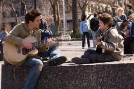 Jonathan Rhys Meyers and Freddie Highmore in August Rush