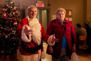 Billy Bob Thornton and Brett Kelly in Bad Santa 2
