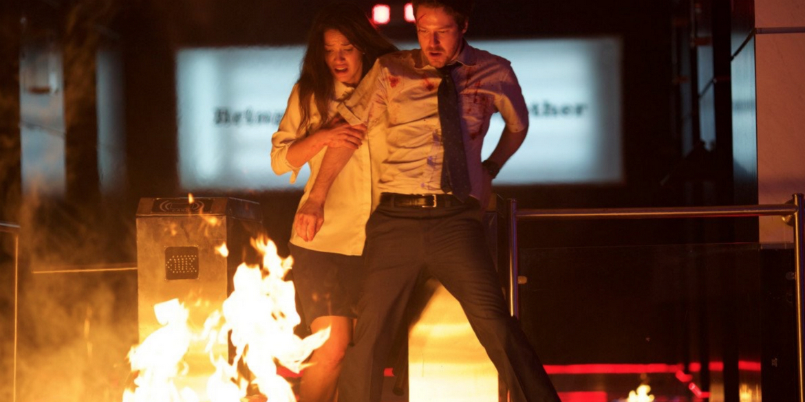 Adria Arjona and John Gallagher Jr. in The Belko Experiment