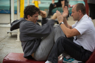 Miles Teller and Aaron Eckhart in Bleed for This
