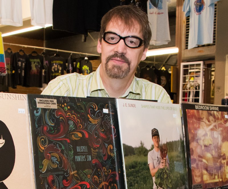 Bob Herrington with some LPs from his Cartouche Records label.