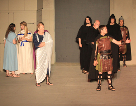 Bob Hanske, Tyler Henning, and ensemble members in Coriolanus