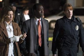 Jennifer Esposito, Don Cheadle, and Kathleen York in Crash