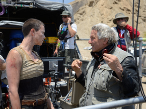 George Miller directing Charlize Theron in Mad Max: Fury Road