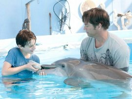 Nathan Gamble and Harry Connick Jr. in Dolphin Tale