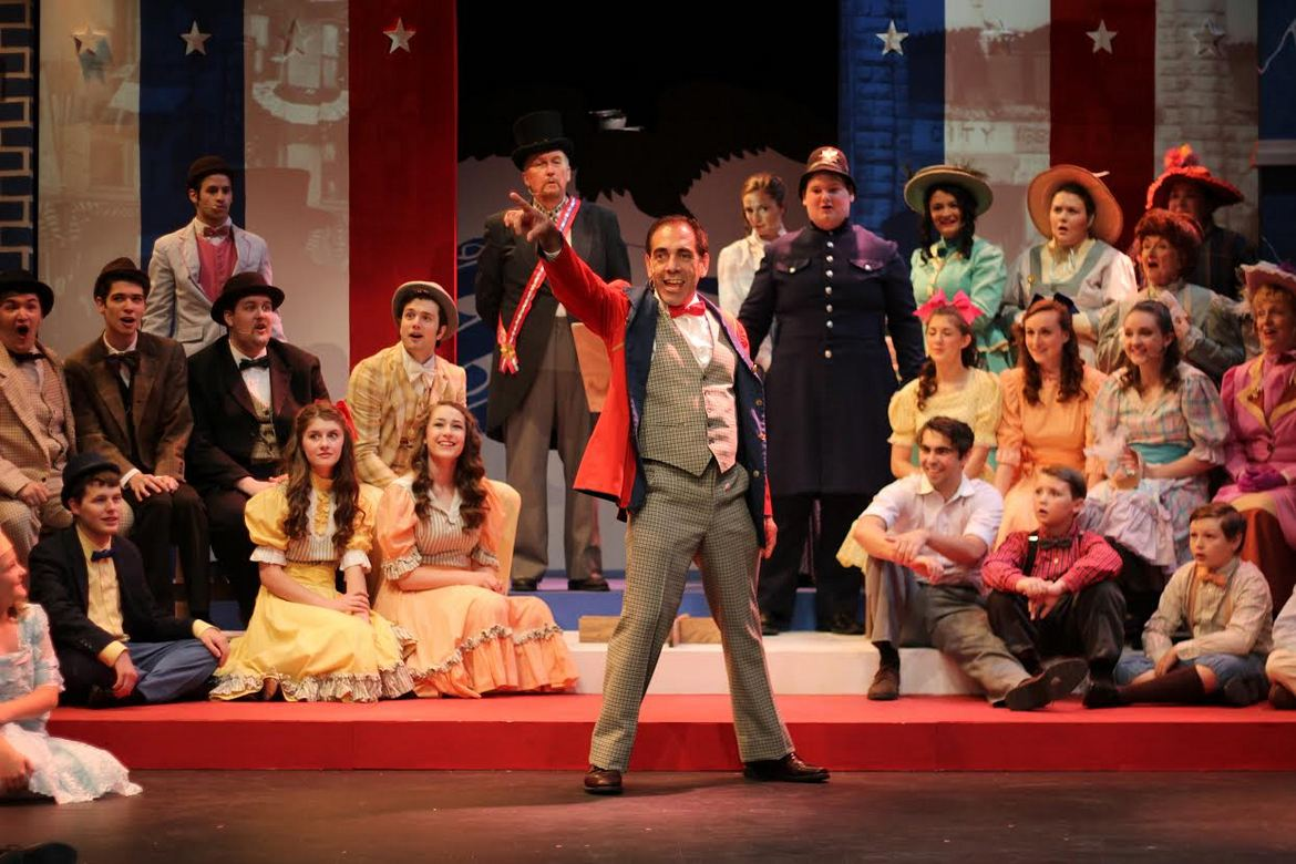 Jay Berkow and ensemble members in The Music Man