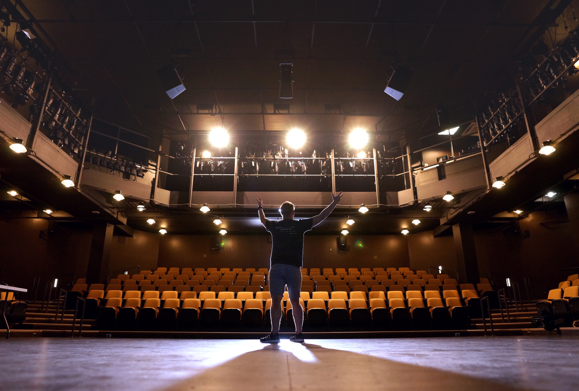 Keenan Odenkirk on the mainstage of Augustana College's Kim & Donna Brunner Theatre Center, photo by Paul Colletti
