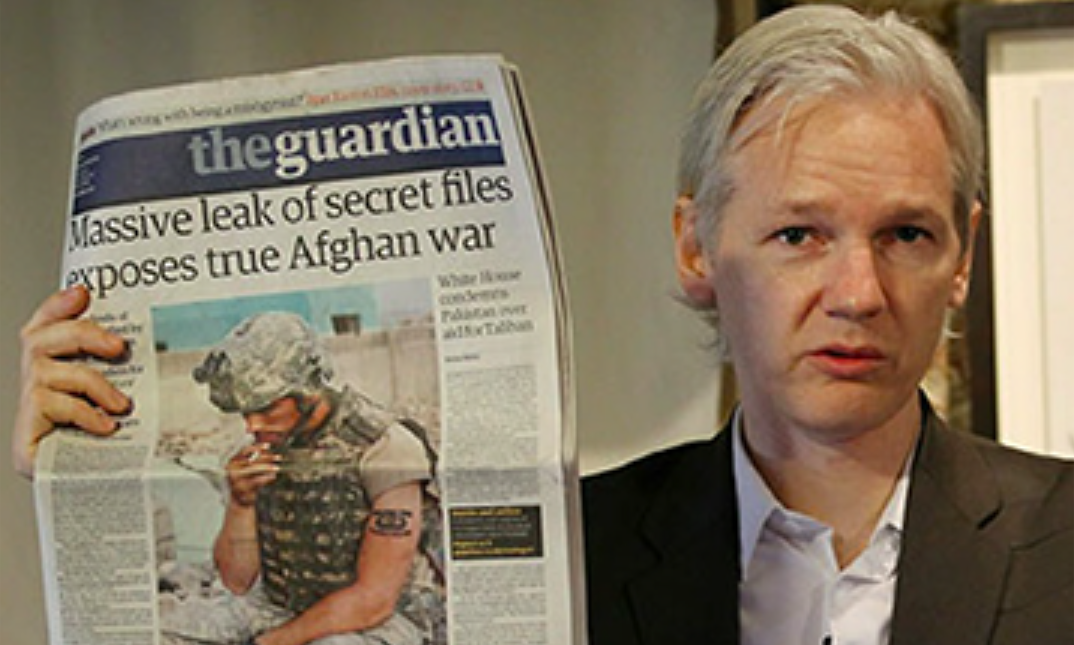 Julian Assange Holding Guardian Newspaper Afghan War Logs