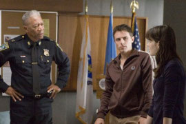 Morgan Freeman, Casey Affleck, and Michelle Monaghan in Gone Baby Gone