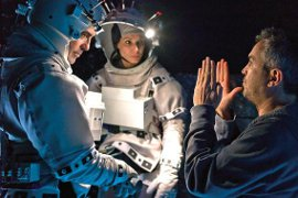 Alfonso Cuarón directs George Clooney and Sandra Bullock in Gravity
