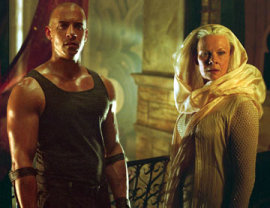 Vin Diesel and Judi Dench in The Chronicles of Riddick