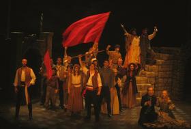 ensemble members in Les Misérables