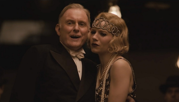 Robert Glenister and Sienna Miller in Live by Night