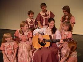 Liz J. Millea and the Von Trapp children in The Sound of Music