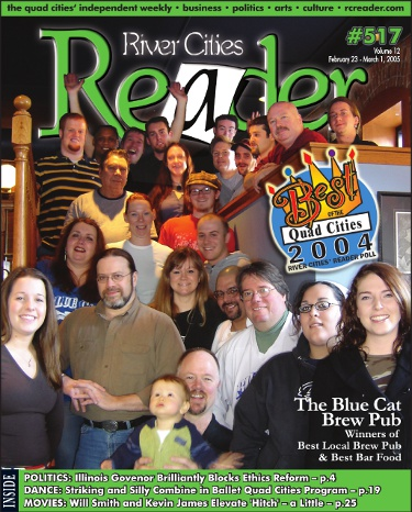 Bob Murdock (bottom center) holding his son Montgomery with his Blue Cat family on a 2005 cover of the River Cities' Reader