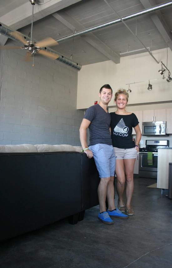 Nathan Carroll and Kelly Komadino in their apartment in the Peterson Paper Company building, to which they moved last month. Carroll moved from the Crescent Lofts, where he'd lived for four years.