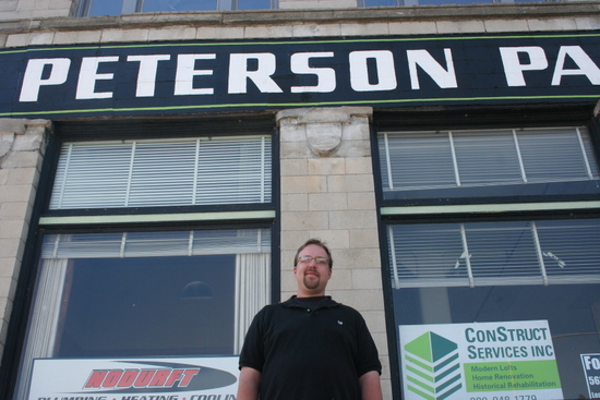 Developer Joe Erenberger in front of the Peterson Paper Company building