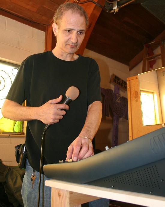 Rob Cimmarusti working on an audio-equipment installation at Progressive Baptist Church in Davenport on January 4, 2013.