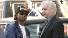 Jason Mitchell and Paul Giamatti in Straight Outta Compton