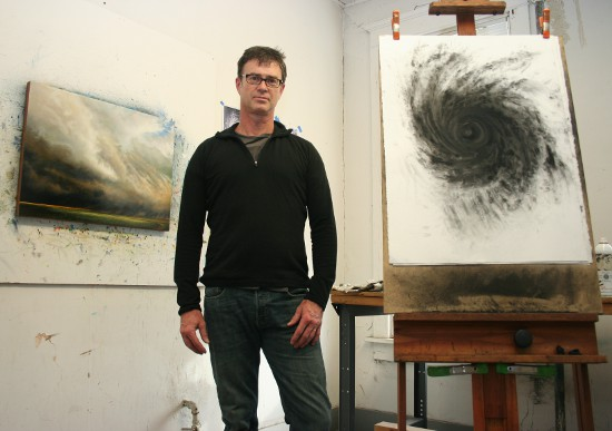 Drew Starenko with some of his recent work in his downtown-Davenport studio.