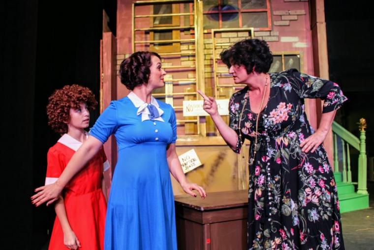 Emily Winn, Sara Tubbs, and Julie Wilson Funk in Annie