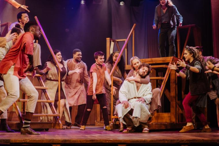 Claire Soulier, Ben Cherington, and ensemble members in Jesus Christ Superstar