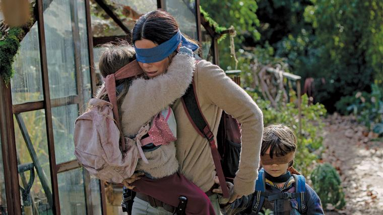 Vivian Lyra Blair, Sandra Bullock, and Julian Edwards in Bird Box