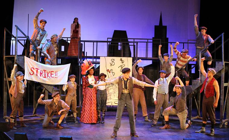 Noah Lindquist and company members in Newsies: The Musical