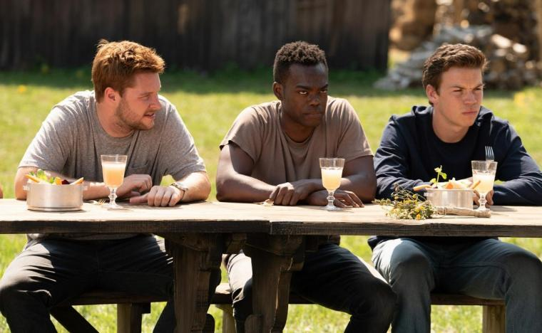 Jack Reynor, William Jackson Harper, and Will Poulter in Midsommar
