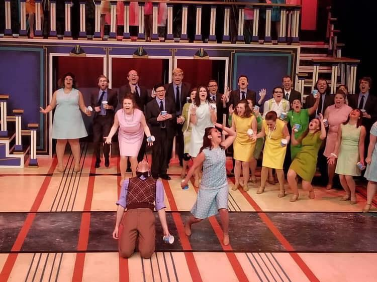 ensemble members in Augustana College's How to Succeed in Business Without Really Trying