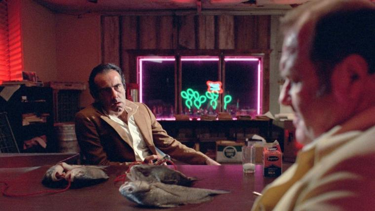 Dan Hedaya and M. Emmet Wash in Blood Simple