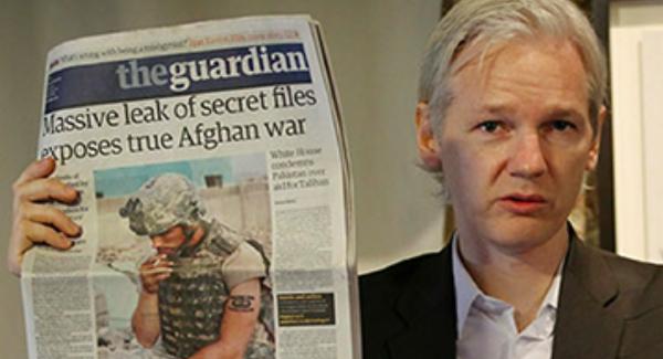 Julian Assange Holding Guardian Newspaper Afghan War Logs