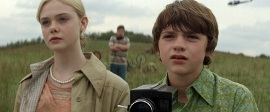 Elle Fanning and Joel Courtney in Super 8