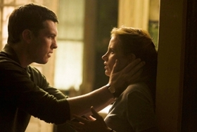Sam Worthington and Jessica Chastain in The Debt
