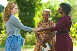 Emma Stone, Octavia Spencer, and Viola Davis in The Help