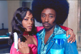 Aunjanue Ellis and Eddie Griffin in Undercover Brother