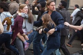 Mireille Enos and Brad Pitt in World War Z